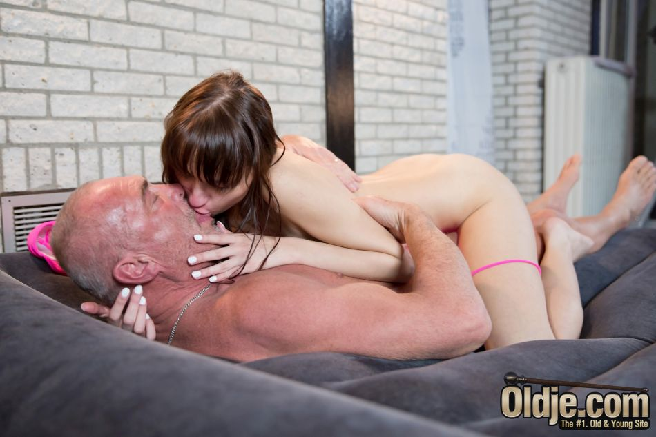 Older man and young girl kissing and teasing